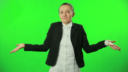 Businesswoman shrugging against a green background