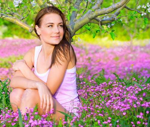 Cute girl in floral garden