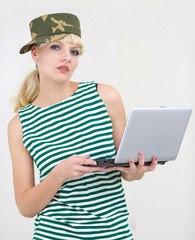 Girl in army cap with laptop