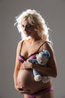 Young Pregnant Woman With A Toy