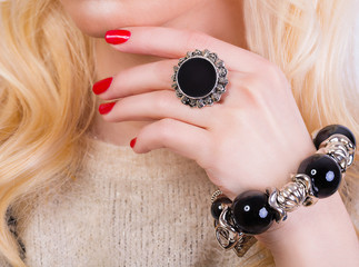 Beautiful blonde girl with red manicure