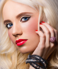 Beautiful model with red lips and manicure
