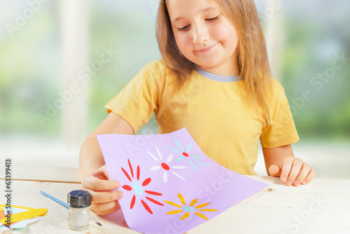 Girl with greeting card for mother