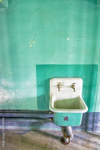 White sink and a green wall inside