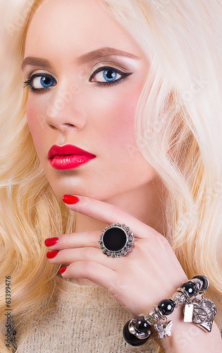 Beautiful blonde girl with red lips and manicure