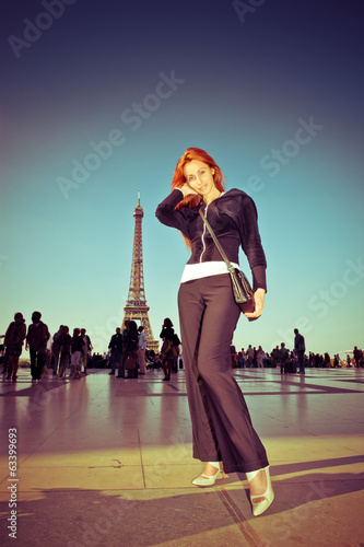 young woman against Tour d'Eiffel,with a retro effect