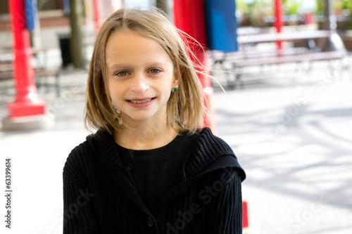 Tween girl outside.