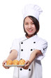 woman chief served plate of croissant