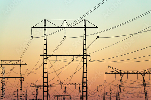 ectricity pylons on colorful evening sky