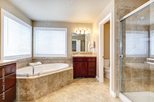 Modern bathroom with round tub and shower