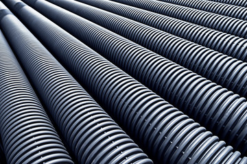Close up of black plastic pipes with diminishing perspective