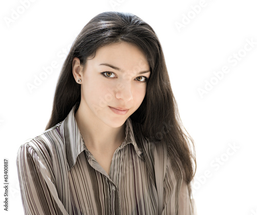 Beautiful brunette girl face closeup isolated on white.