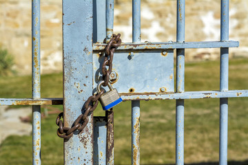 Outside prison gate with a locked chain