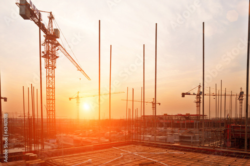 Staande foto Industrial geb. buildings under construction with sunset