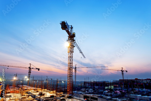 buildings under construction with sunset - 63401044