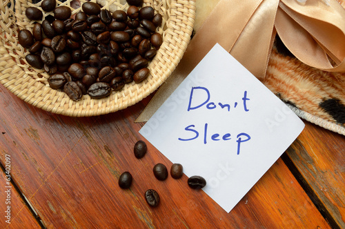 coffee beans in basket and don't sleep note on the wooden