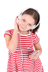 Beautiful little girl listening to music, isolated on white