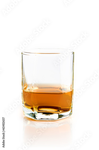 Empty glass with flowing whiskey