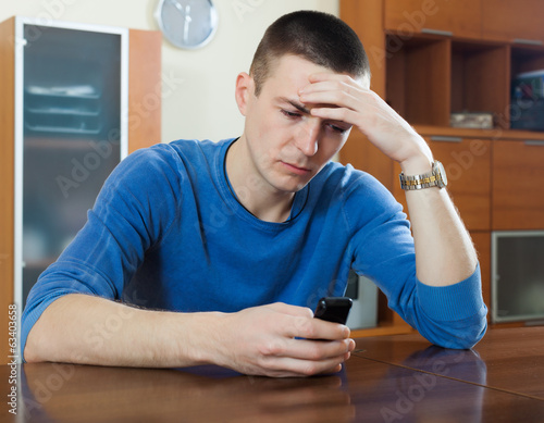 Unhappy guy with phone