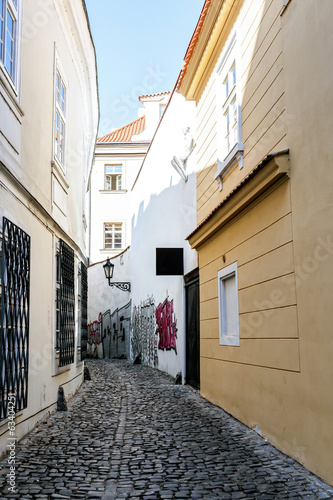 A small narrow street in the old town area of Prague