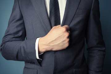 Businessman grabbing his jacket