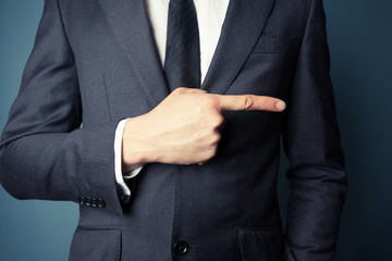 Businessman pointing right