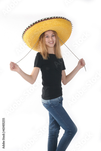 teenage girl tries on a sombrero