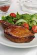 Grilled steak with vegetables on bone