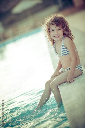 canvas print picture Child in swimming pool