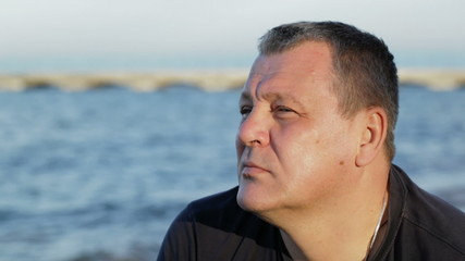 Thoughtful man by the sea