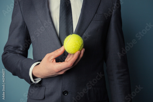 Businessman with tennis ball