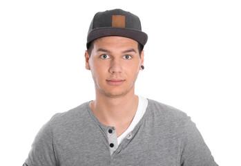 Gesicht: junger Mann isoliert und ernst auf weiß
