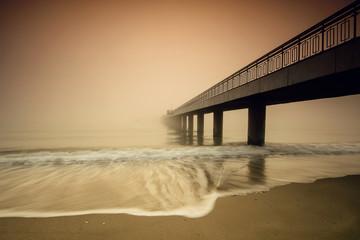 Bridge in a misty morning
