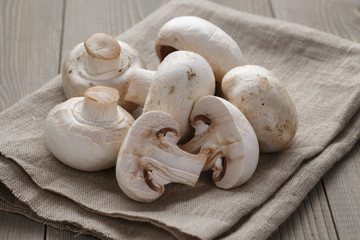 fresh white champignon on wood table