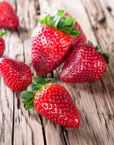 Strawberry over Wooden Background