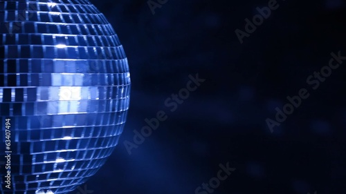 Disco ball over dark background