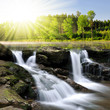 Waterfall in spring landscape