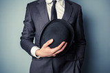 Man holding a bowler hat