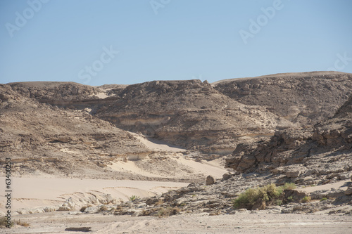 Dry river valley through a rocky desert