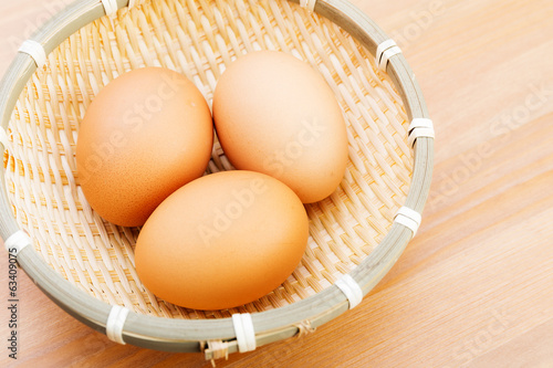 Brown chicken egg in basket