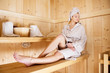 Woman relaxing in sauna