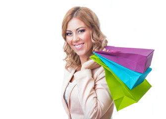 Cheerful young girl holding shopping bags