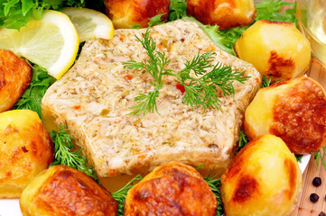 Aspic from meat with roasted potatoes and fresh herbs