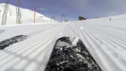 Skiing downhill rear view