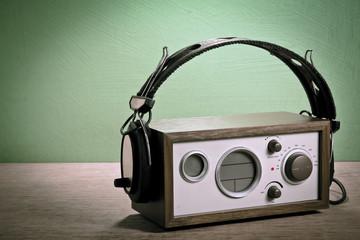 modern radio and headphones retro style,  mint green background,
