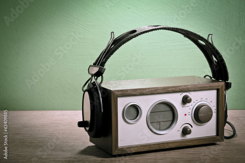 modern radio and headphones retro style,  mint green background,