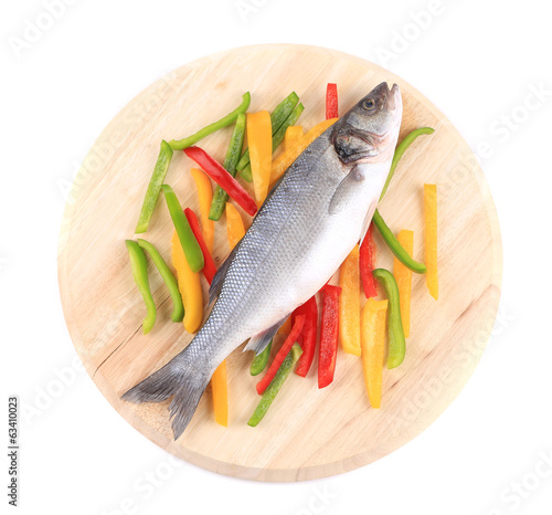 Fresh seabass fish on colorful pepper.