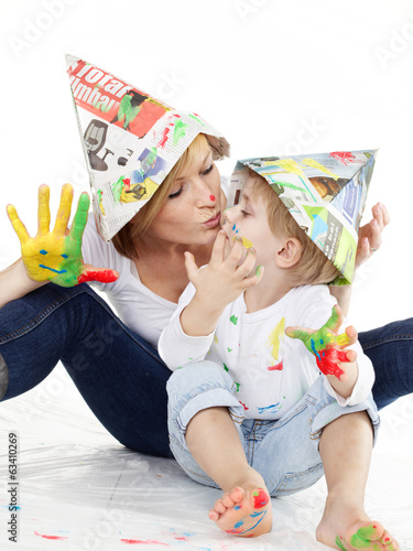 canvas print picture Cute boy and mother have coloured hands, playing together