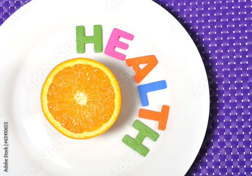 fresh healthy Orange Fruit stillife and health word