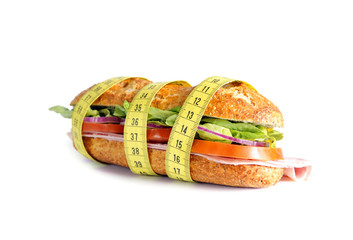 Vegetable Sandwich wrapped in measure tape in diet concept